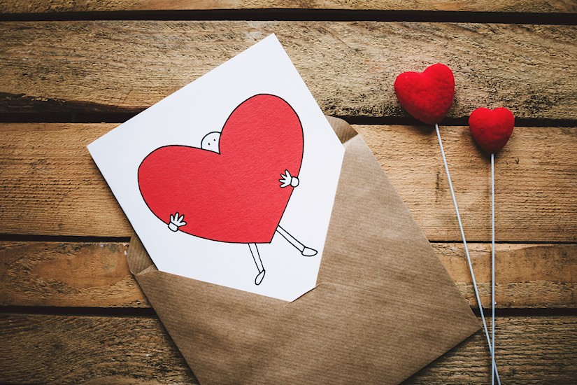 white black and red person carrying heart illustration in valentine image